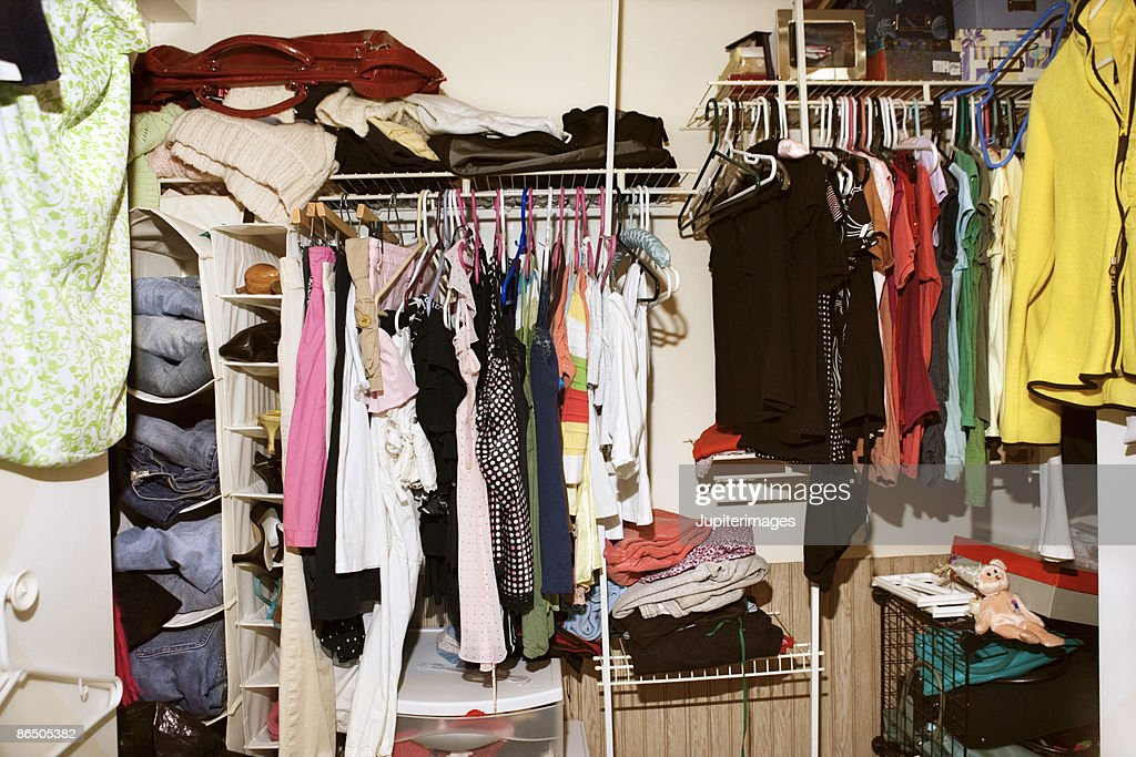 Clothes in woman's closet : Stock Photo