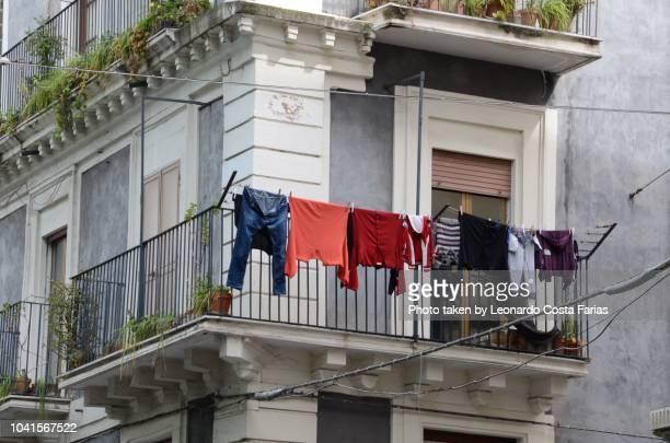 clothes line - leonardo costa farias stock photos and pictures