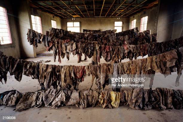 Clothes of victims of the Rwandan genocide are on display at the Murambi memorial site February 23 2003 in Murambi outside Gikongoro Rwanda 10000...