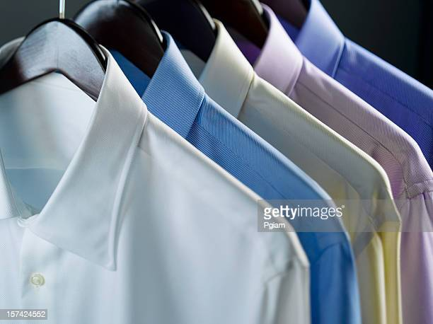 clothes on a hanger - dry cleaner stock pictures, royalty-free photos & images