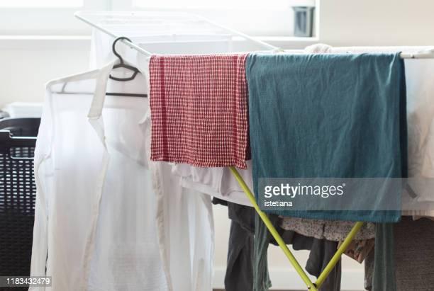 clothes on drying rack - 乾かす ストックフォトと画像