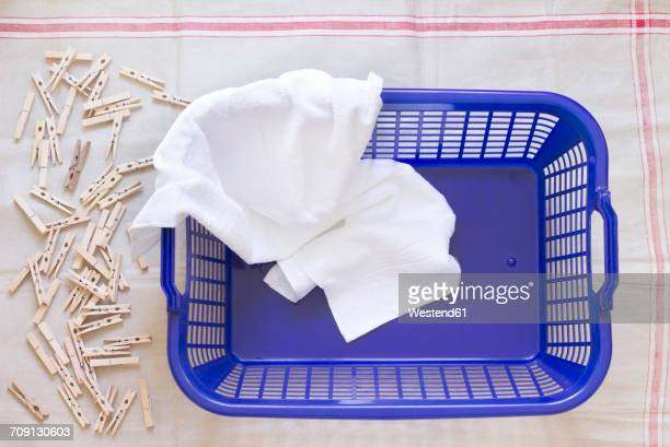 clothes pegs, laundry basket and towel on cloth - clothespin stock pictures, royalty-free photos & images