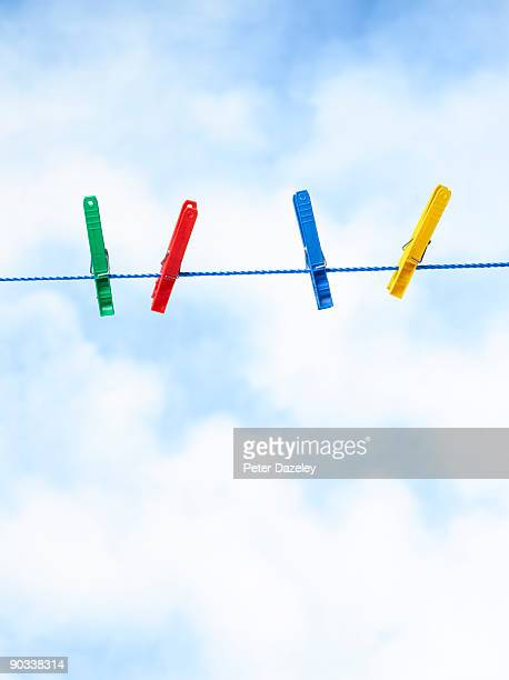 Clothes pegs on washing line.