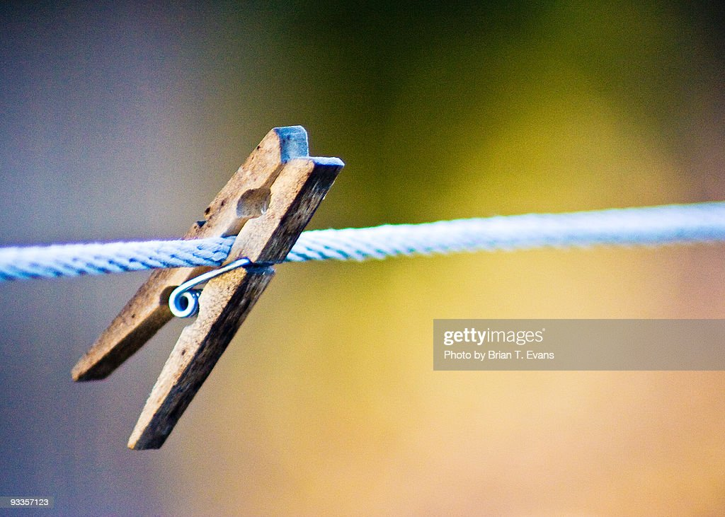 A Clothes pin Hanging On : Stock Photo