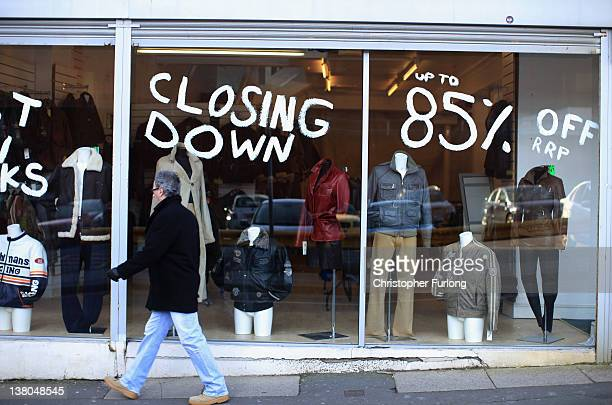 A clothes shop tries to sell the last of its stock before closing down on February 1 2012 in StokeOnTrent England Staffordshire has borne the brunt...