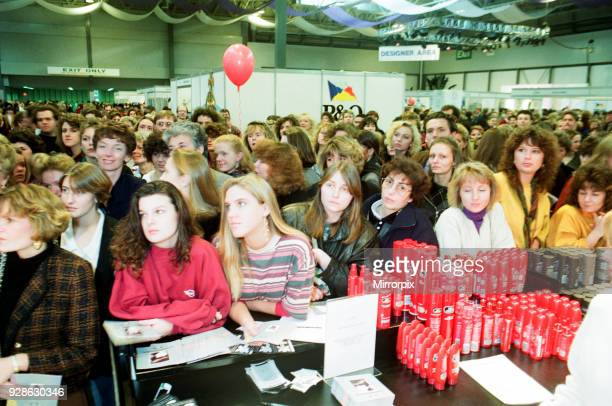 Clothes Show Live, NEC, Birmingham, 7th December 1991. Amanda Shuttleworth talks to the crowd as she prepares Joanne Greenwood, from Halifax, for a...
