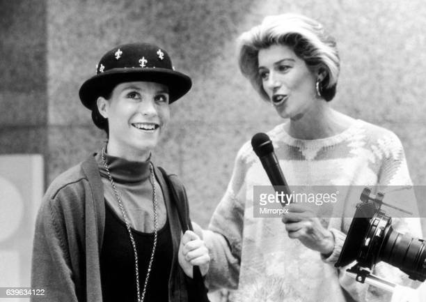 Clothes Show, Sarah Dunwell from Brownhills takes to the catwalk with Selina Scott at The Pavillions shopping centre, 7th September 1989.