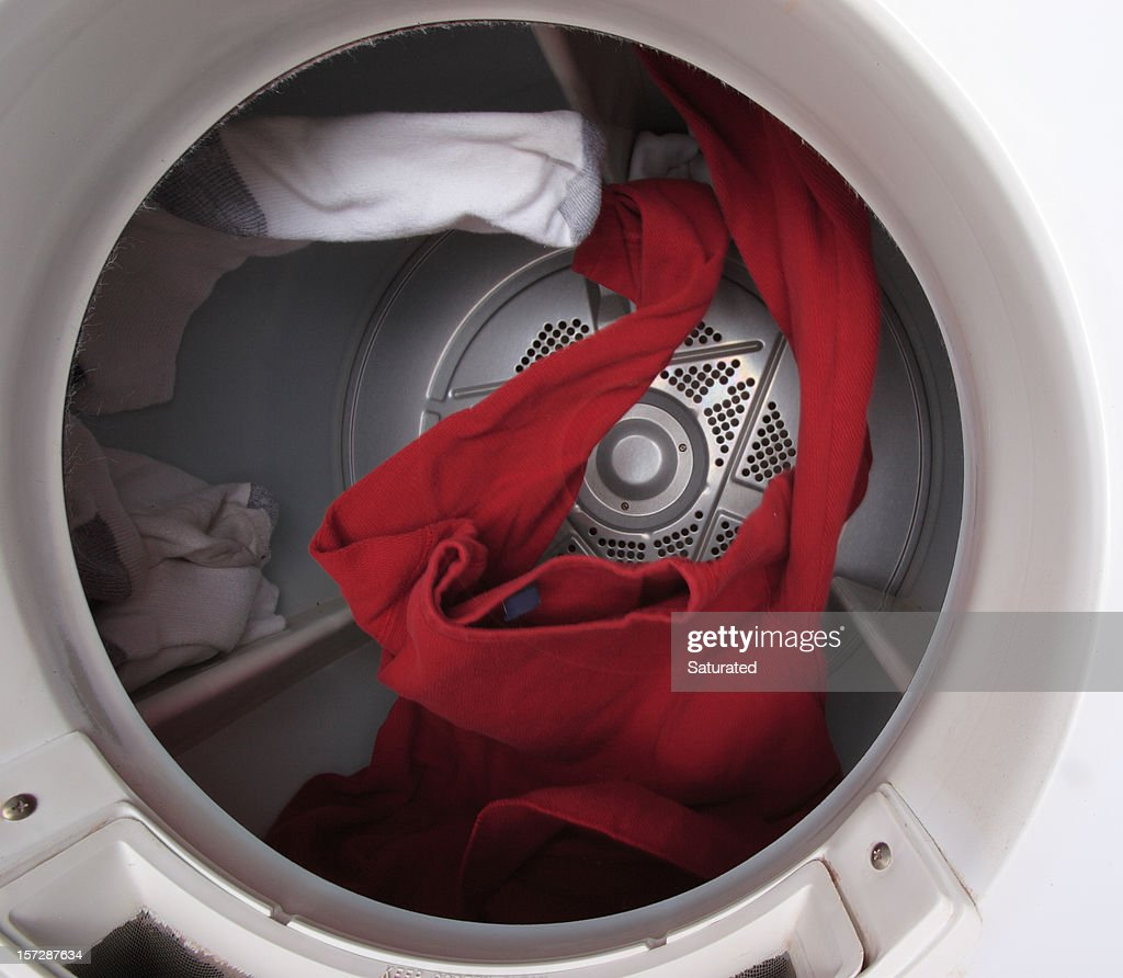Clothes Tumbling in Dryer : Stock Photo