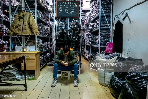 A clothes wholesale booth in the ecommerce base in Hangzhou where wholesalers supply clothes goods for Taobao shop owners Taobao founded by the...