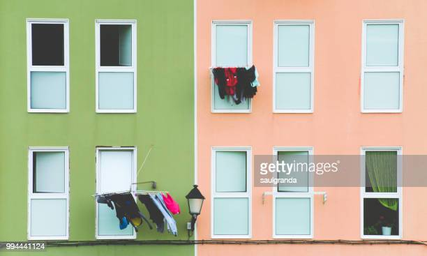 Clotheslines on a colorful facade