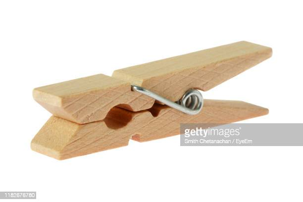 clothespin against white background - clothespin stock pictures, royalty-free photos & images