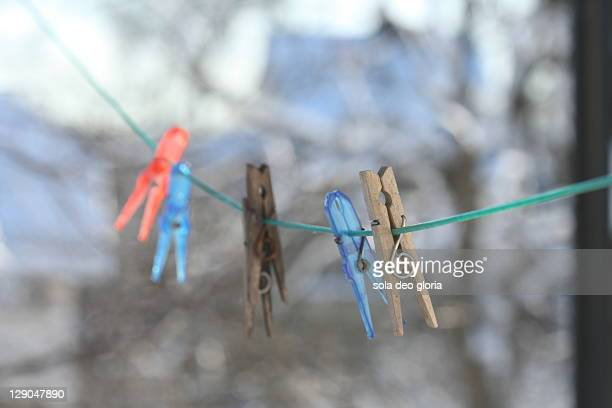 Clothespin hanging on line