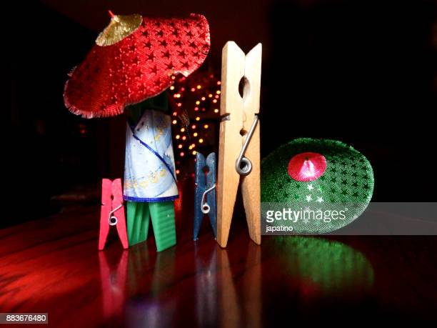 Clothespins disguised as Chinese people watching the Christmas lights