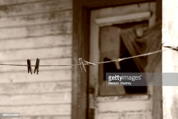 Clothespins on Line, old abandoned farmhouse
