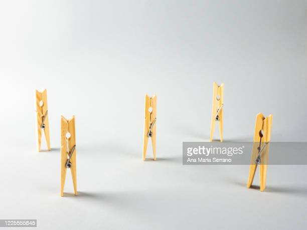 clothespins representing the concept of social distance - new normal stock pictures, royalty-free photos & images