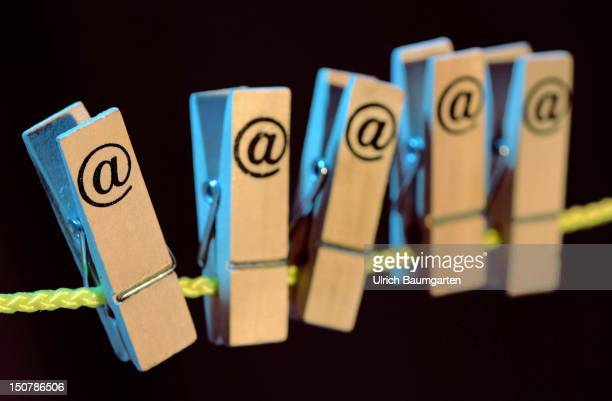 Clothespins with atsigns on a clothesline Symbolic picture for Economy internet