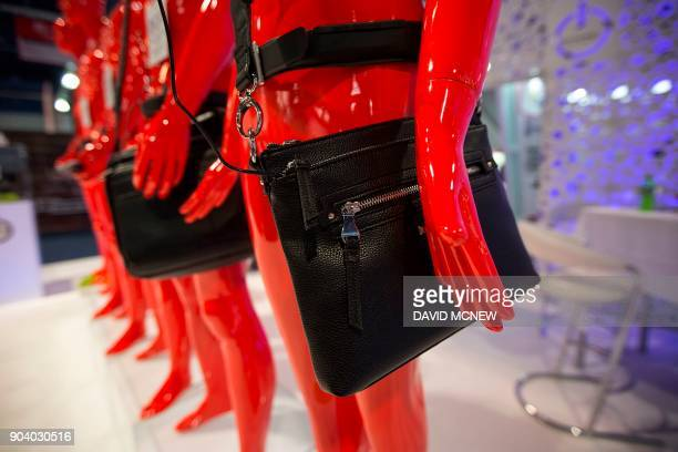 Clothing accessories that power devices are displayed at the Battery Belt exhibit during CES in Las Vegas Nevada January 11 2018 / AFP PHOTO / DAVID...