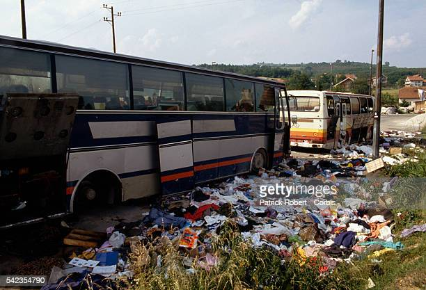 Clothing and belongings lay scattered around an abandoned bus in the village of Polie during the Yugoslavian Civil War The bus was attacked by...
