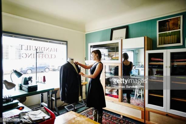 Clothing designer draping garment on dress form