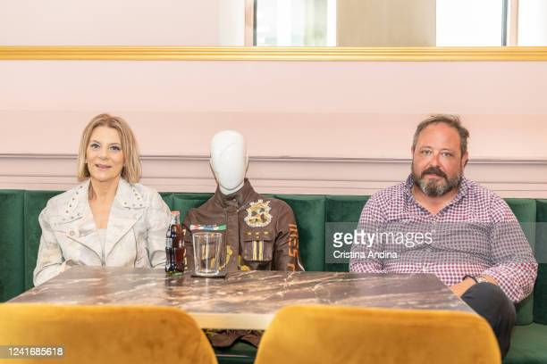 Clothing designer Inés Penelas and the owner of the coffee shop La Fundación Miguel Yáñez pose with a dressed mannequin to show fashion trends and...
