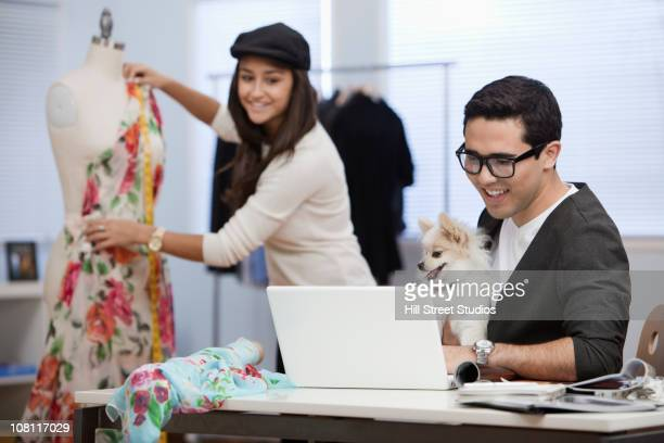 clothing designers working in workshop together - one animal stock pictures, royalty-free photos & images
