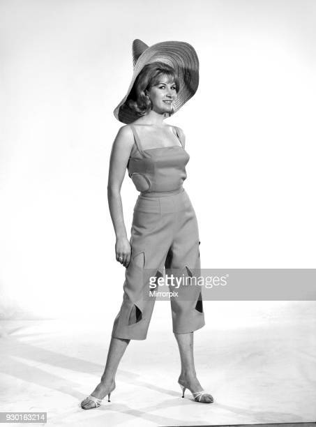 Fashion Beachwear Woman wearing µ length trousers with holes and a hat Model Caron Gardner 1965