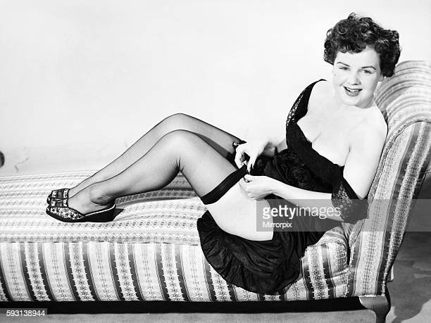 Fashion Stockings and garters Model sitting in armchair with telephone E144006