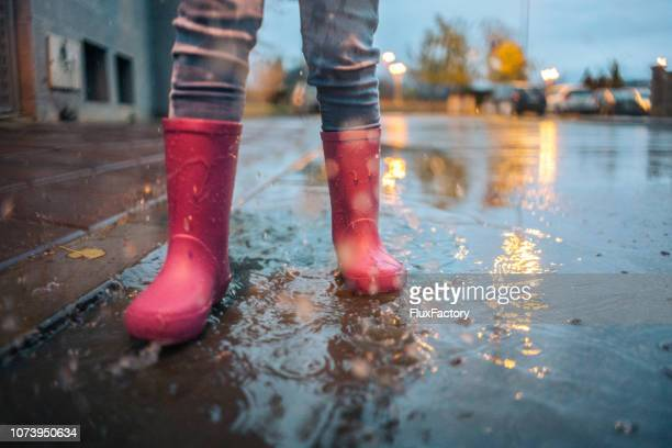 clothing for bad weather is important - slow motion stock pictures, royalty-free photos & images