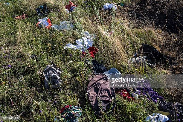 Clothing from the crash of Malaysia Airlines flight MH17 is strewn in the grass at the crash site on July 20 2014 in Grabovo Ukraine Malaysia...