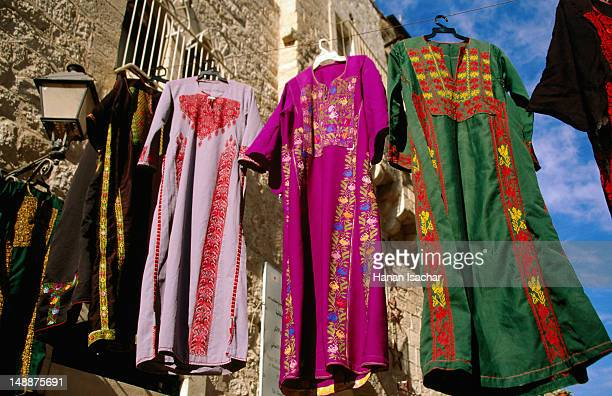 clothing hanging at the market. - palestinian stock pictures, royalty-free photos & images
