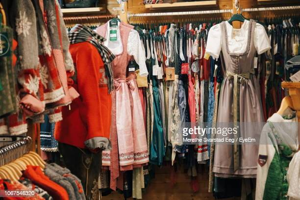 clothing hanging in store - traditional clothing stock pictures, royalty-free photos & images