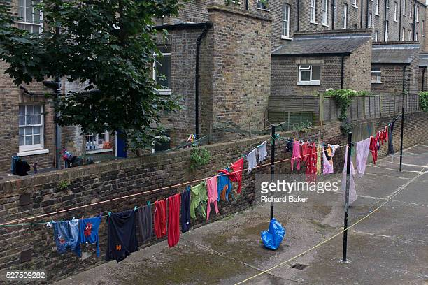 Clothing hanging on a washing line in a Pimlico housing estate in London. Reflecting a bygone era when the residents of inner-city tenements and...