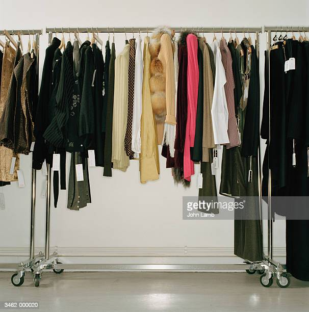 clothing hanging on store rack - clothes rack stock pictures, royalty-free photos & images