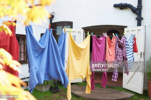 clothing hanging on the washing line - drying stock pictures, royalty-free photos & images