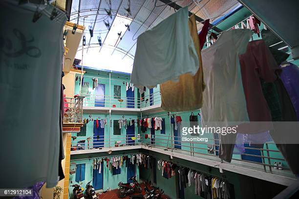 Clothing hangs from washing lines at a guest house that provides accommodation to workers of the Samsung Electronics Vietnam Co Plant in Ap Don...