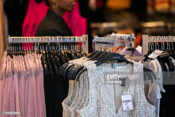 Clothing hangs on display for sale at a Forever 21 Inc. Store in the Union Square neighborhood of New York, U.S., on Thursday, Aug. 29, 2019. Forever...