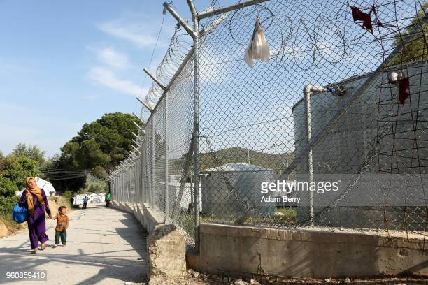 Clothing hangs snagged on razor wire at the Moria refugee camp on May 20 2018 in Mytilene Greece Despite being built to hold only 2500 people the...