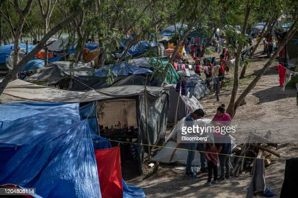 Clothing hangs to dry at a makeshift migrant camp for asylum seekers in Matamoros, Tamaulipas state, Mexico, on Sunday, March 1, 2020. The San...