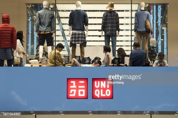 Clothing is displayed on mannequins for sale in a Uniqlo store operated by Fast Retailing Co in the Ginza area of Tokyo Japan on Tuesday Aug 21 2018...