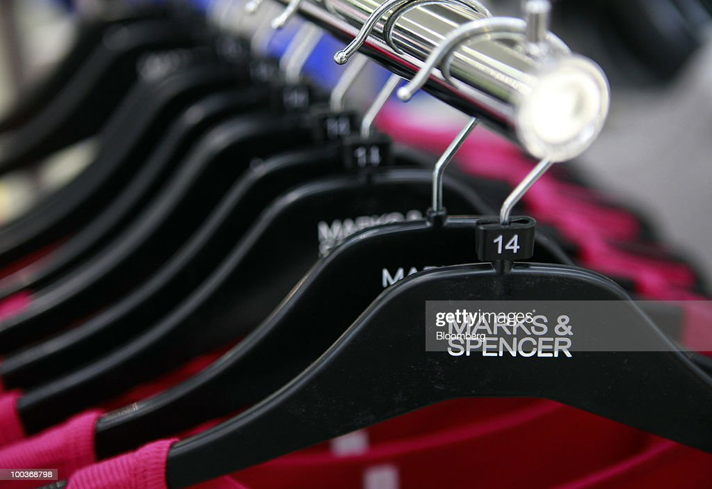 Clothing is seen on a rack at a Marks & Spencer Group Plc (M&S) store in The Westfield Centre shopping mall in London, U.K., on Monday, May 24, 2010. The company, the U.K.'s biggest clothing retailer, reports its full-year earnings tomorrow. Photographer: Jason Alden/Bloomberg via Getty Images