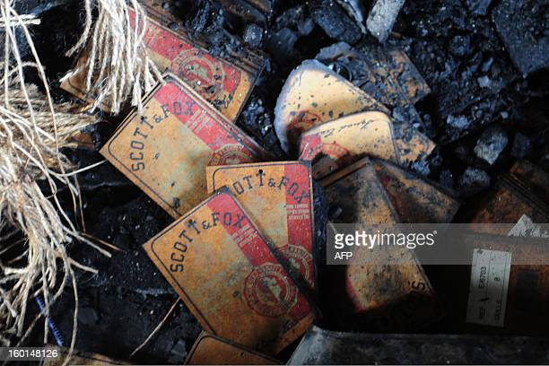 Clothing labels from 'Scott Fox' lie amongst devastation after a fire swept though the garment factory in Dhaka on January 27 2013 At least seven...