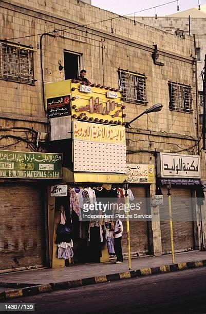 Clothing merchant and street scene in Amman Jordan