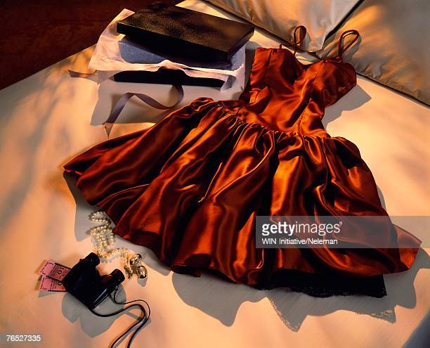 clothing on bed, elevated view - evening gown stock pictures, royalty-free photos & images