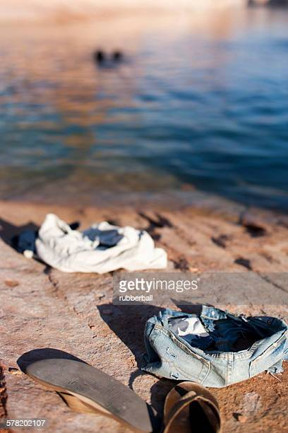 clothing on ground - skinny dipping stock photos and pictures