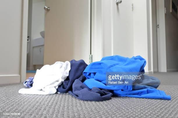 Clothing on Home Carpet Outside Bathroom