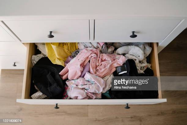 clothing organized by color before and after - tidy room stock pictures, royalty-free photos & images
