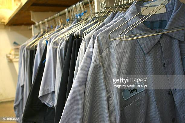 clothing rack of mens work shirts on hangers - fauci stock pictures, royalty-free photos & images
