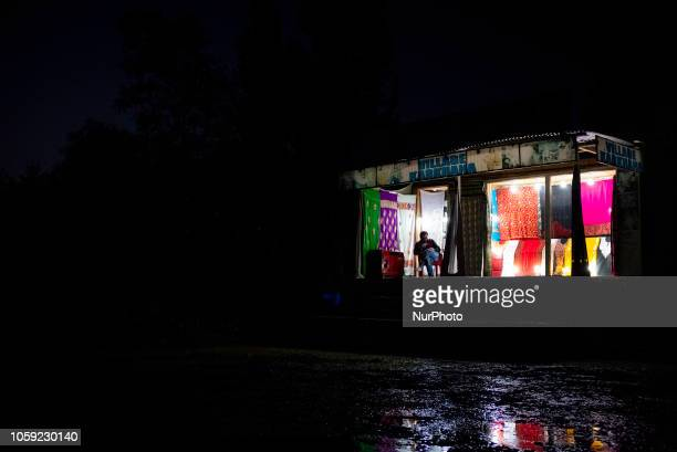 A clothing shop on Dal Lake stays open later than usual in hopes of more business Tourism in the Kashmir region of India has dropped in recent months...