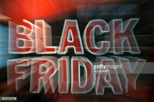A clothing shop promotes 'Black Friday' discounts at the Trafford Centre shopping mall in Manchester northwest England on November 25 2016 Black...