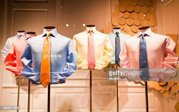 clothing store display of colorful men's shirts and ties - overhemd en stropdas stockfoto's en -beelden